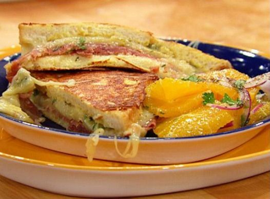 Delicious Savory Italian-Style Monte Cristo Sandwiches by Rachel Ray show. It has the recipe picture and video. #stuffedfrenchtoast #stuffed #french #toast #ham #montecristosandwich