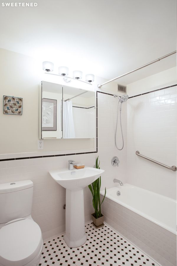 Clinton Hill All White Bathroom Features A Cast Iron Tub Grab Bar For Shower And Toto Sink Toilet