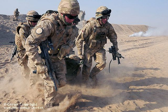 Soldiers from the Royal Anglian Regiment practice their medical emergency skills at Camp Bastion, Helmand, Afghanistan, where regular training is the key to combat effectiveness.