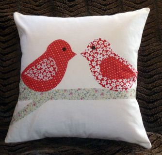 Two love birds sitting on a branch, on a plain background. Can be made in the colours and fabrics of your choice. Please message me with your requirements.