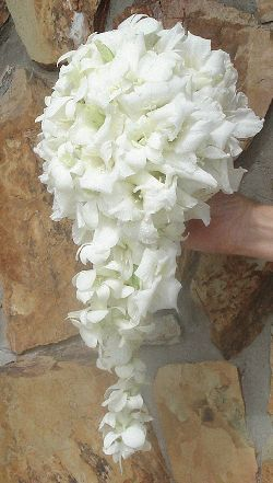 Cascading glamelia with dendrobium orchids florets.  #glamelia  #compositebouquet #cascadingbouquet