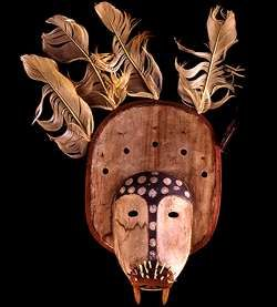 Yup'ik Shaman's Mask: Like nepcetat, (shaman masks) the plaque of this walrus mask has five holes beside which five carved animals originally sat. Five feathers decorate the rim. The mask is small and may have been worn as a forehead mask.