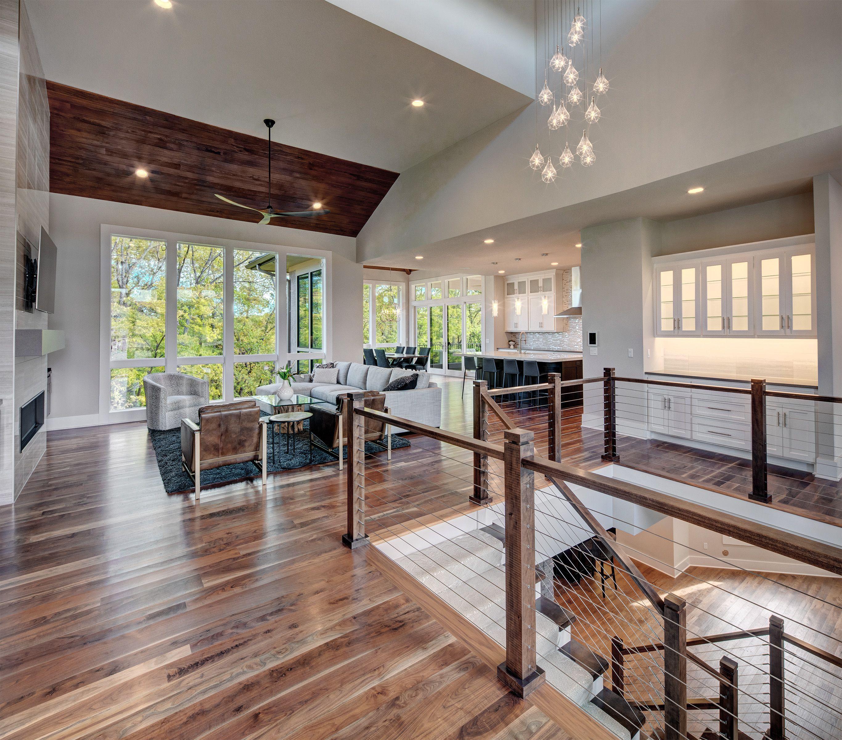 Modern Home Open Floor Plan Hanging Light Fixtures Large Entryway Home New Homes Custom Home Builders