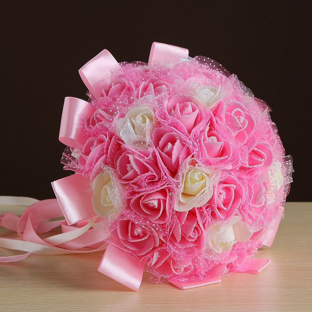 Wedding bouquet artificial silk for bride hand holding flowers