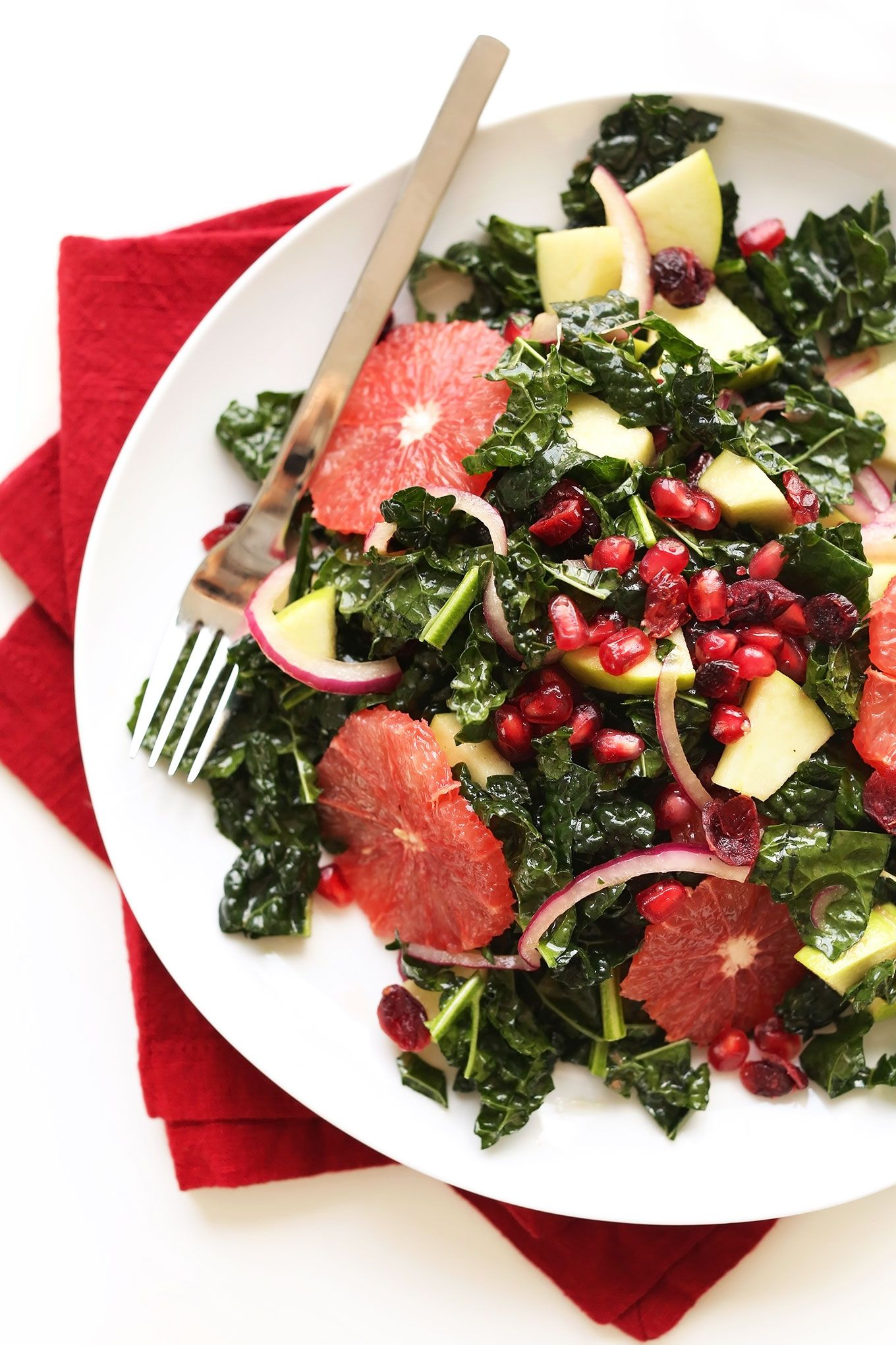 A simple 30-minute kale salad with sweet and tart fruits, pickled red onions, and a simple red wine vinaigrette! Crunchy, filling, fresh, and the perfect healthy light lunch or side salad.