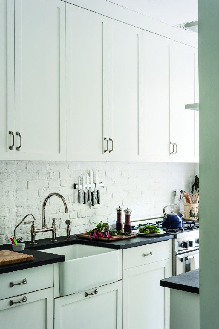 Brooklyn Remodeling Style Collection white galley kitchen with simple hardware and white backsplash