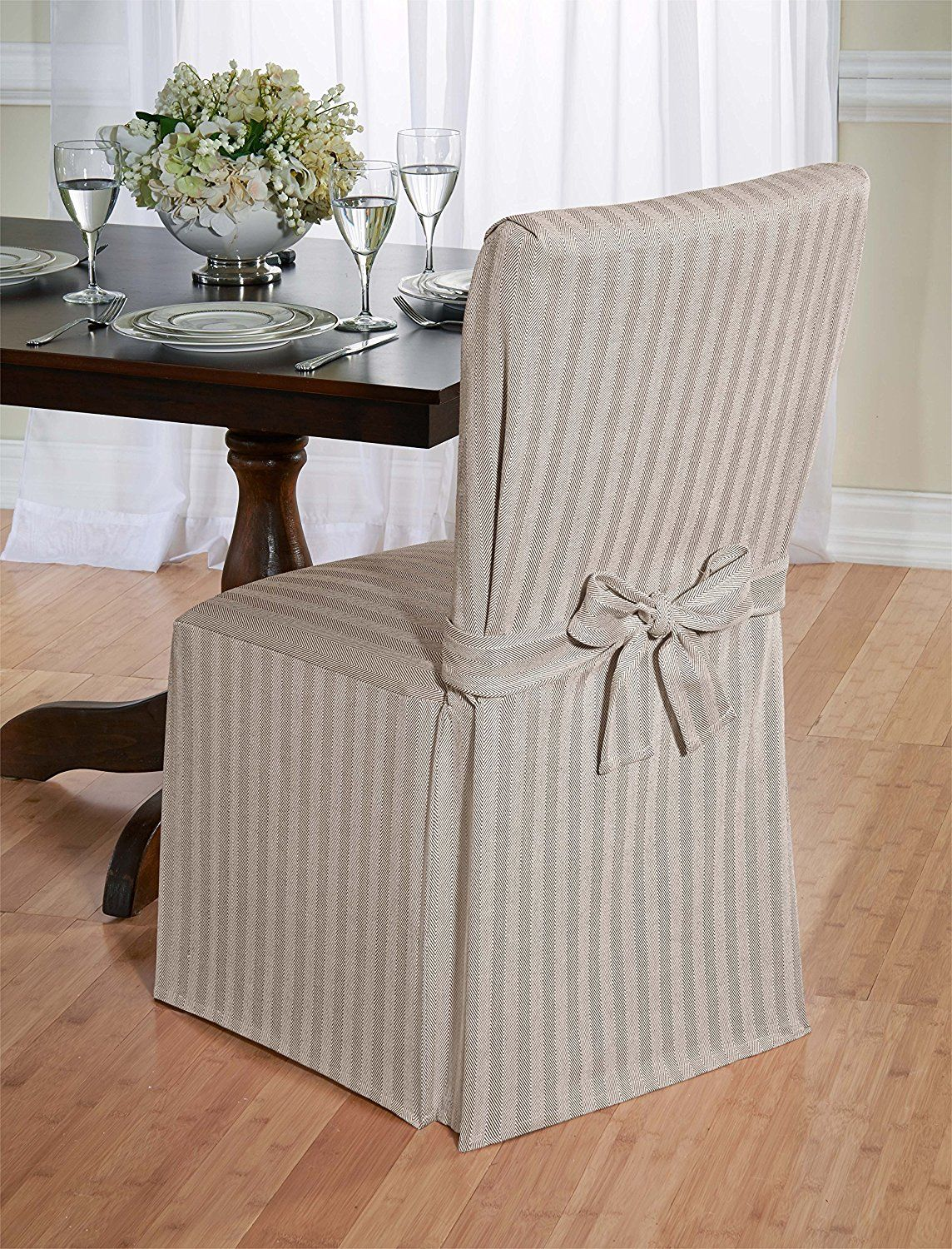 I just love these Dining Room Chair Covers. Change your