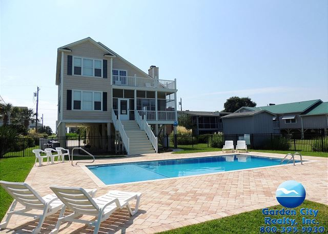 Superb Poohu0027s Corner Is A Four Bedroom, Four Bath Inlet Front Home Located Miles  South Of Garden City Pier And Walking Distance To The Beach.