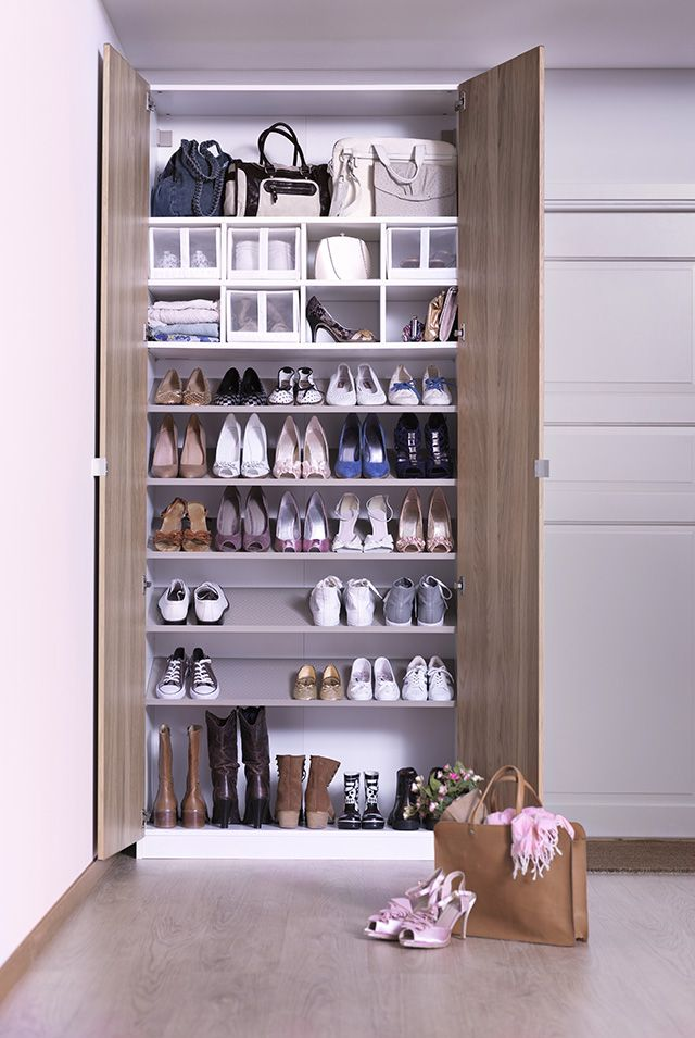wardrobes like the ikea pax system let you add as many shoe shelves