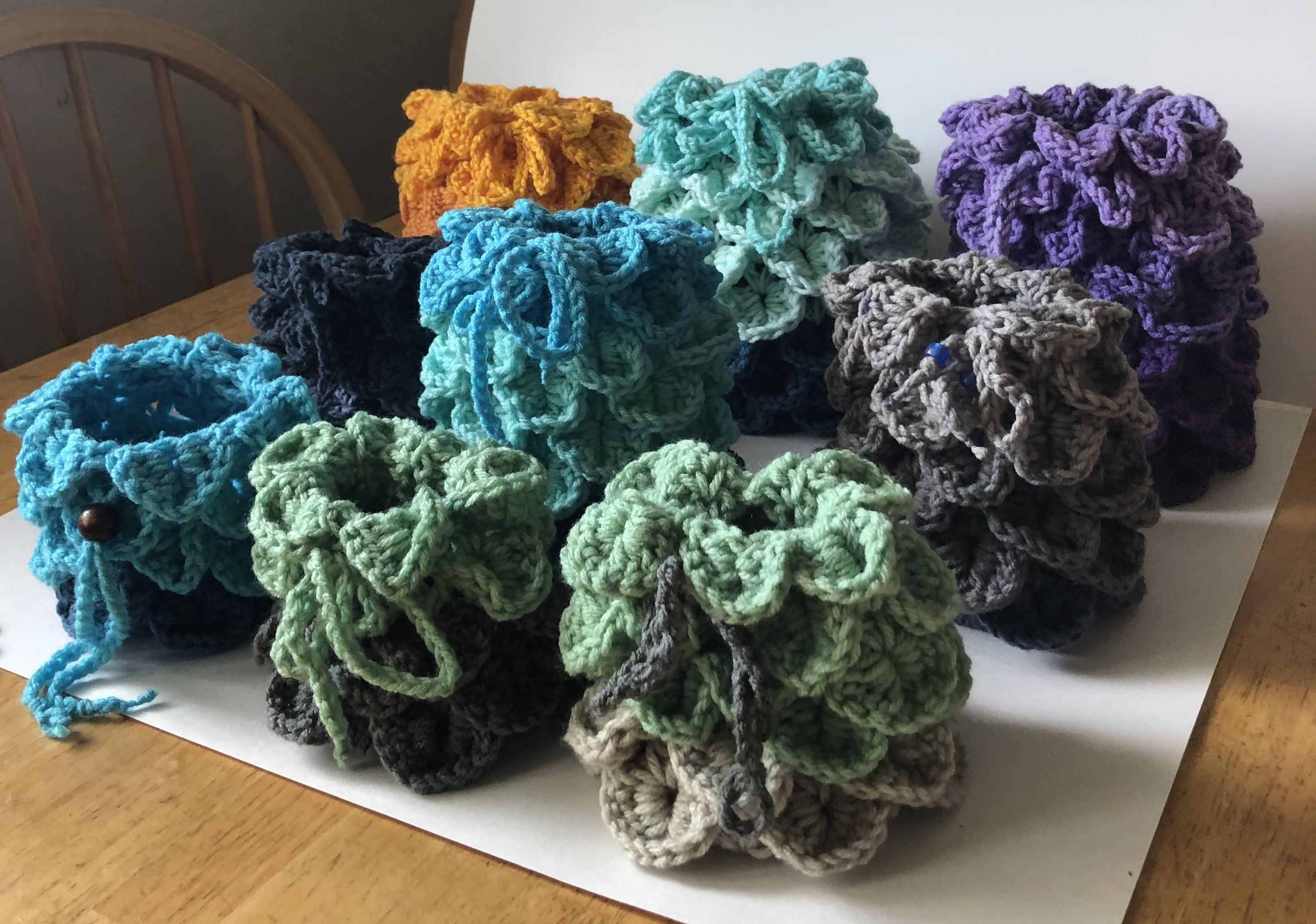 All 9 Dragon Egg Dragon Scales Crocheted Dice Bags great for Dungeons and Dragons, role play and table top gaming! Use for gaming, cosplay or to hold your treasures.  #dragonegg #dragonscales #dnd  #rpg #dungeonsanddragons #dicebag #dicebags #tabletopgaming #tokenpouches #roleplaygames #handmade #crochetedbags #crochetersofinstagram #etsyseller #geektasticcreations #geekgirl #geekystuff #geeklife #roll20dnd #criticalrole #dungeonmaster