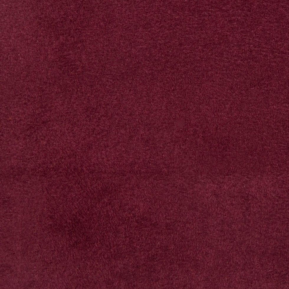 This is a polyester ultra suede in wine. Very fine, great for Upholstery.