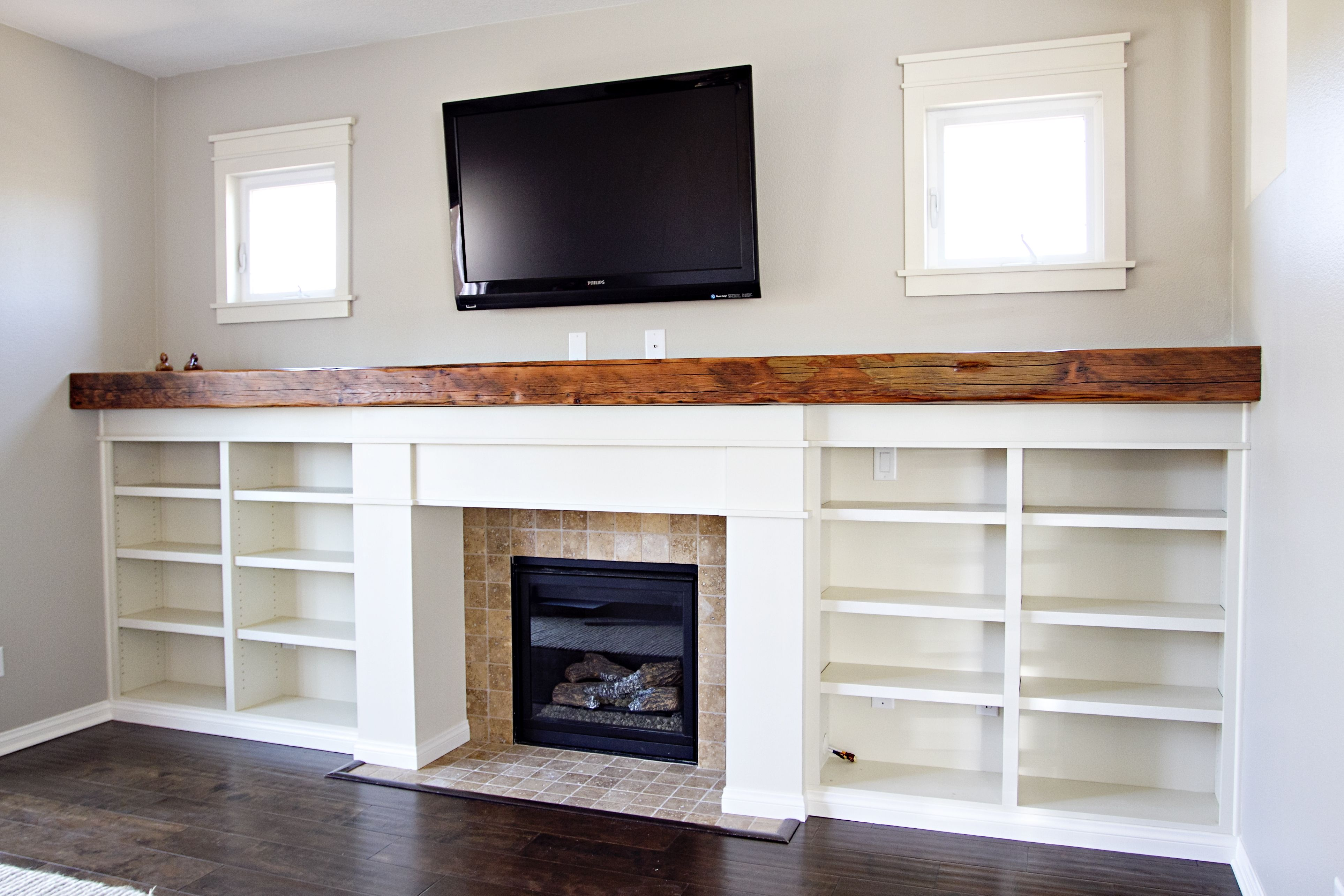 Custom fireplace surround, bookshelves, reclaimed wood ...
