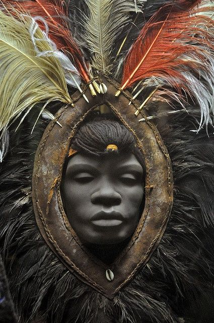 African face with head dress