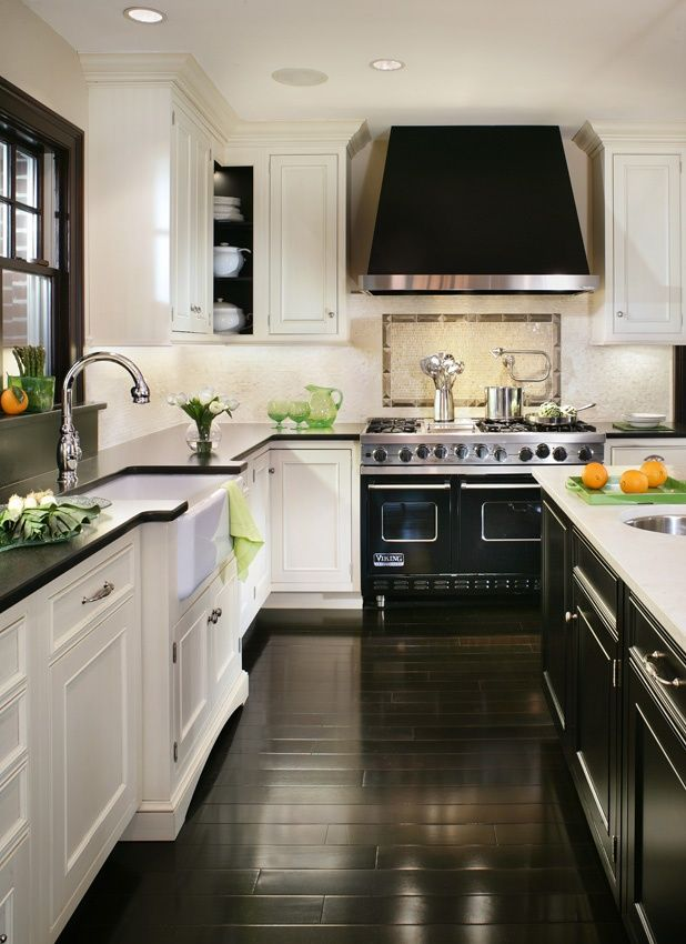 A large range hood brings your eye to the ceiling, making this ...
