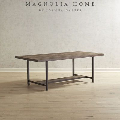 With A Play Of Vertical And Horizontal Lines This Dining Table