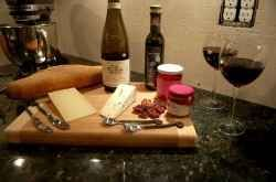 A cheese tray with wine is always romantic for two