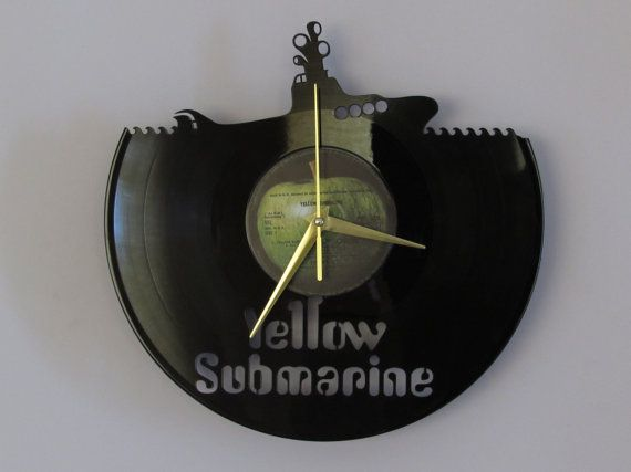 This The Beatles vinyl wall clock, made from a recycled 12 LP, is a really great gift for a vinyl lover or a true beatlemaniac:).   The clock is fitted