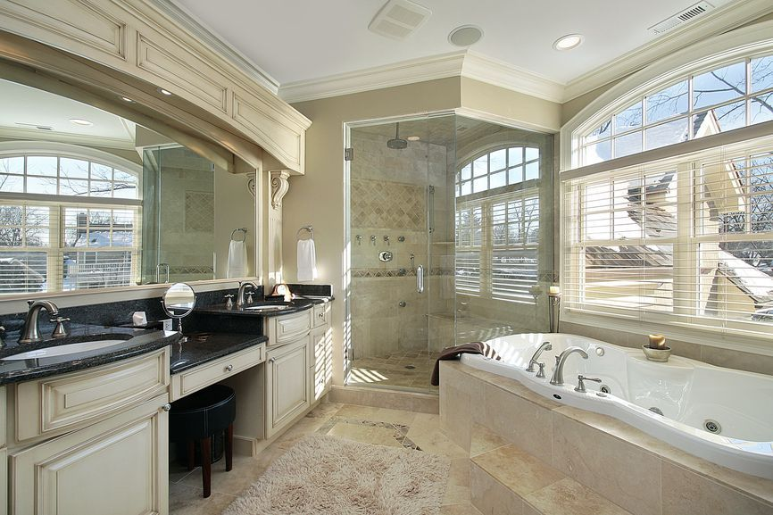 Triangle shaped bathroom with extensive marble glass-shower and ...