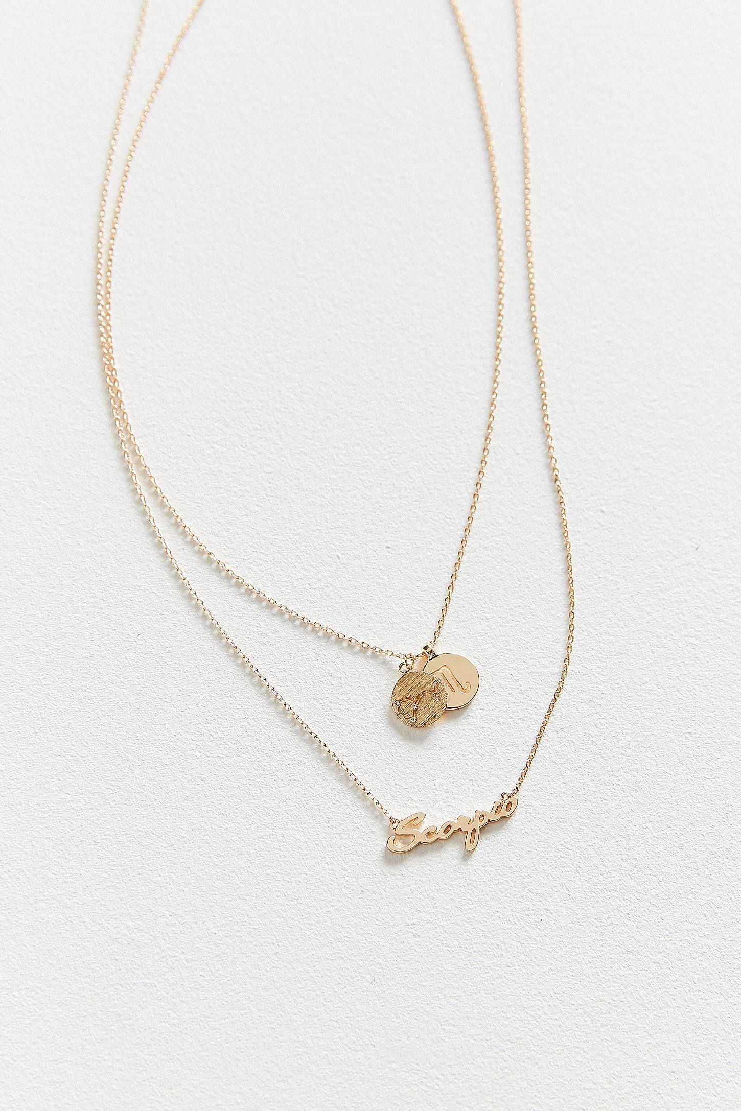 Zodiac layering charm necklace set latest styles urban outfitters