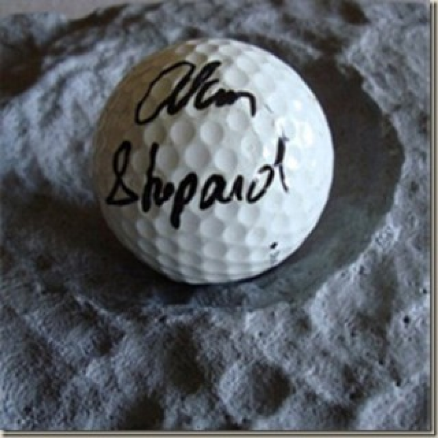 PLAYING GOLF ON THE MOON