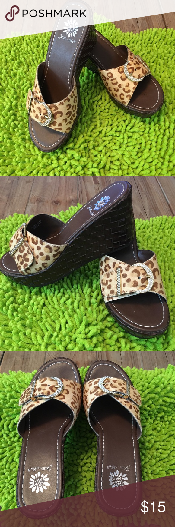 Cheetah Print Wedge Sandals With Bling Cheetah Print Wedge Sandals. Size 6. Yellow Box faux cheetah print sandals with bling buckles. Excellent used condition. YB600 Yellow Box Shoes Wedges