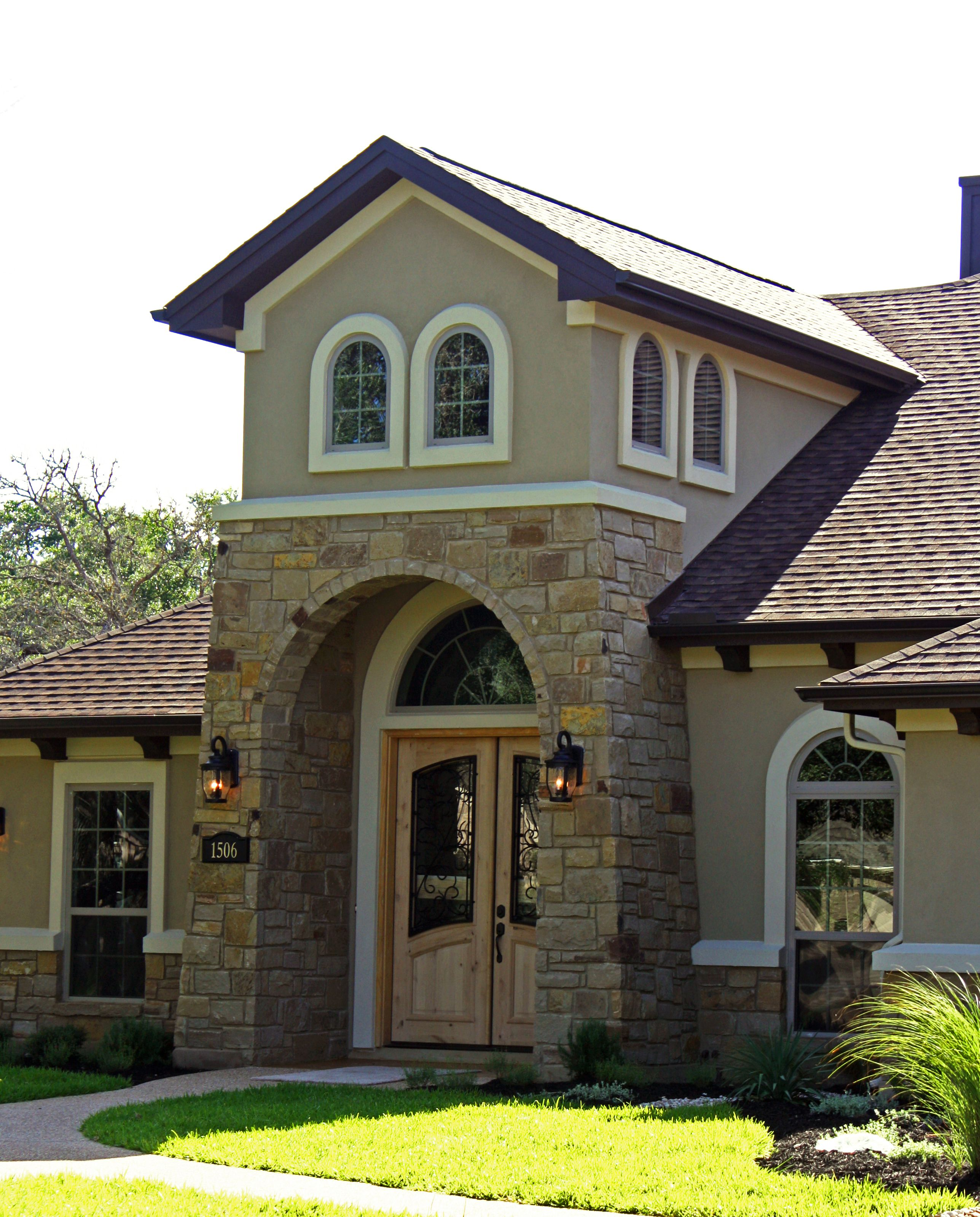 Stone stucco tuscan mediterranean arch wood door for Stucco house plans
