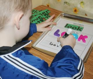 Place the mat on a cookie sheet, have the kids pick a word, build it with magnetic letters and then write it with a dry erase marker (erase when done).