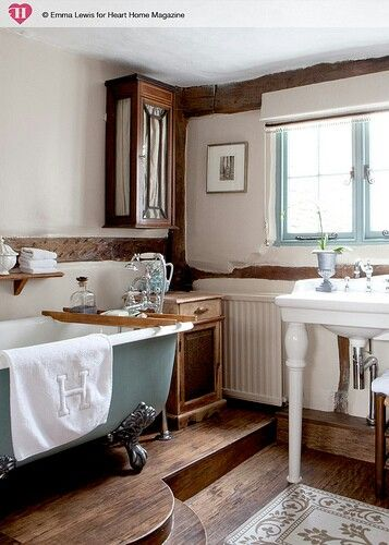 Clawfoot Tub....exposed beams....raised platform for tub....towel cabinet and vanity table.