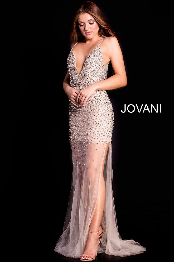 00d1b3fbed4 Floor length form fitting nude mesh prom gown with sheer bottom and side  slit features sleeveless bodice with plunging v neck and low back.