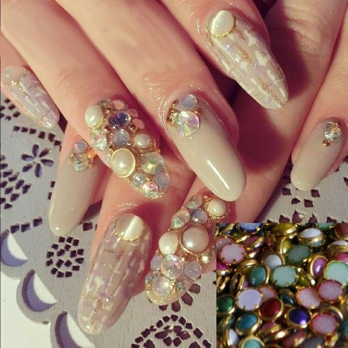 rhinestone nail designs, close up of long round nails, two decorated ...