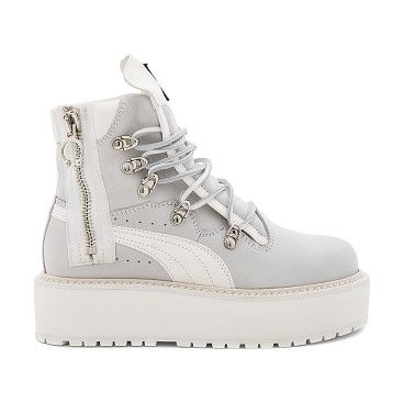 ede6137190e Sneaker Boot by Fenty by Puma. Leather upper with man made sole. Side zip  closure. Lace-up front. Padded tongue and collar. Platform measures approx.
