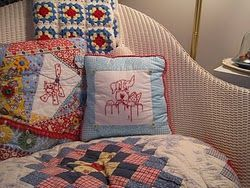 The pillows, the quilt and the granny squares just make me happy!