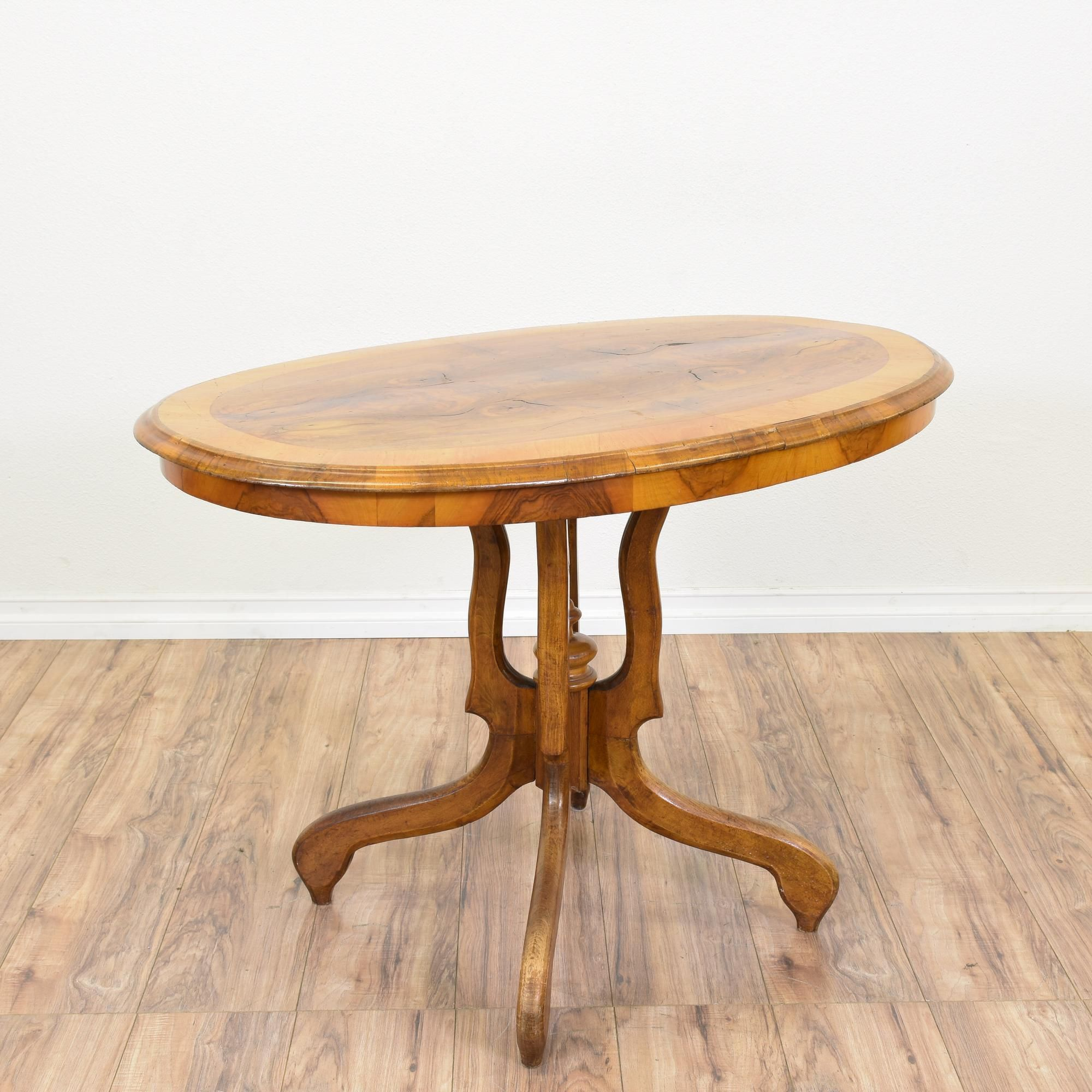 this antique table is featured in a solid wood with a glossy oak