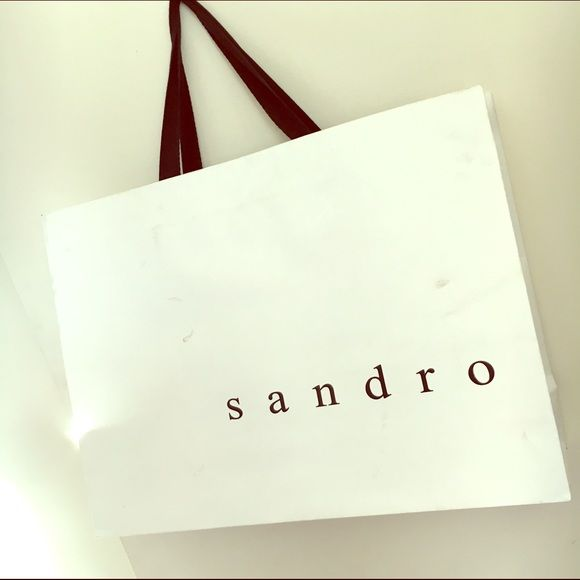 large SANDRO shopping bag!!  Make your sales more professional with a fabulous high end shopping bag! Small dirt stain but Good condition . No trades ✨ Sandro Bags