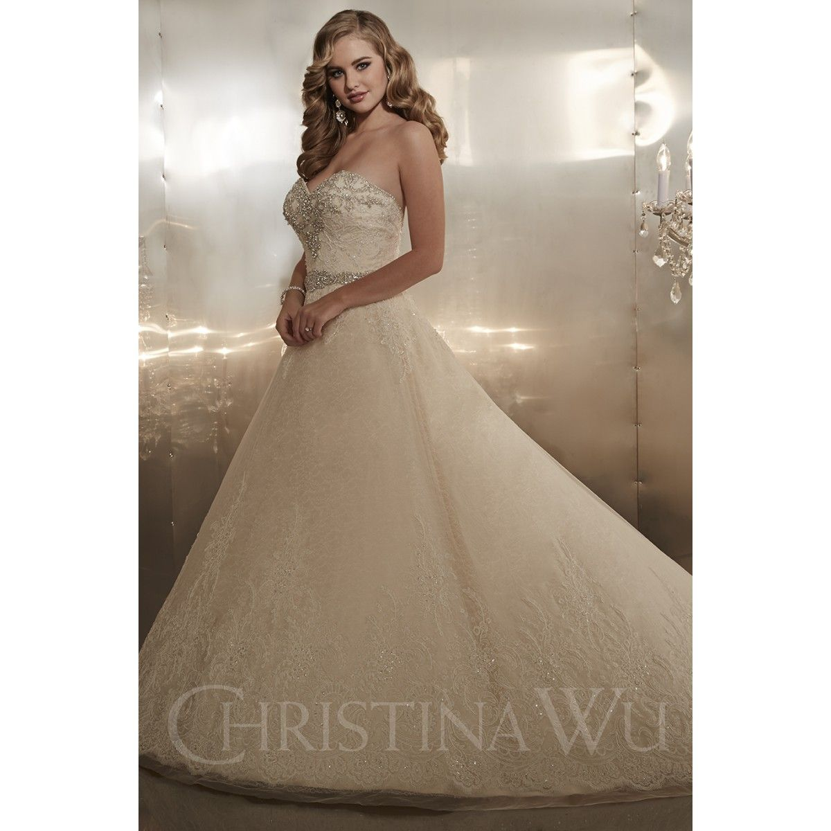 Style strapless aline gown made of lace over satin beaded