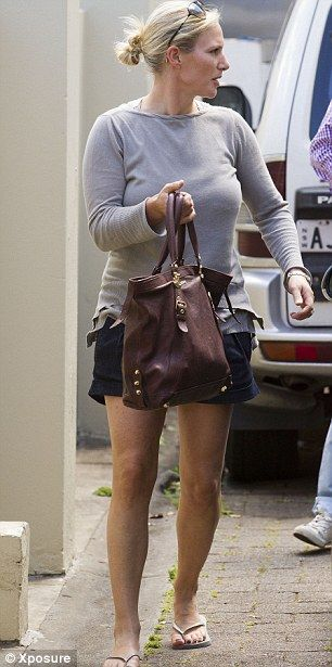Arm candy: She may have been dressed down, but Zara accessorised her beachy look with a gorgeous leather bag by Miu Miu