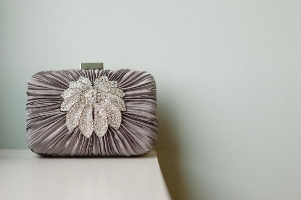 all adoring eyes are on this vintage-esque clutch  Photography by http://melissahayes.net