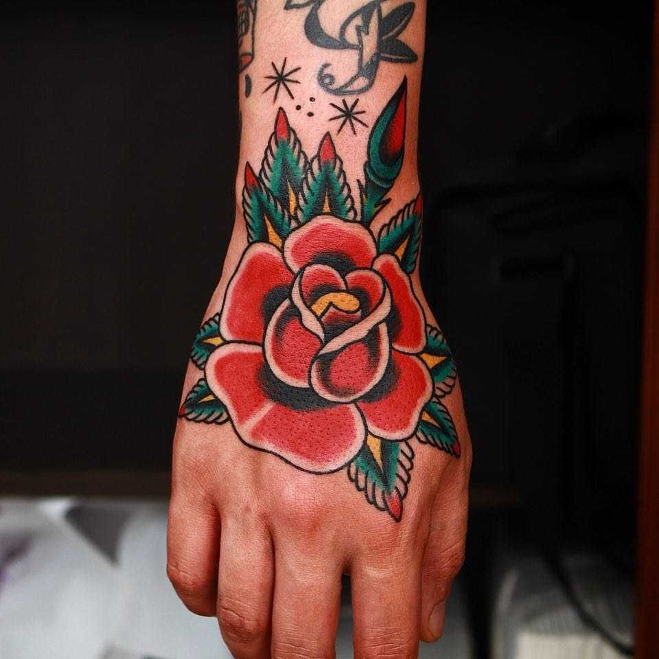 Traditional Style Red Rose Tattoo Inked On The Right Hand By Ssik Boy Traditional Hand Tattoo Hand Tattoos Traditional Rose Tattoos