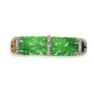 An Art Deco jadeite, diamond and onyx brooch, by Cartier, circa 1925