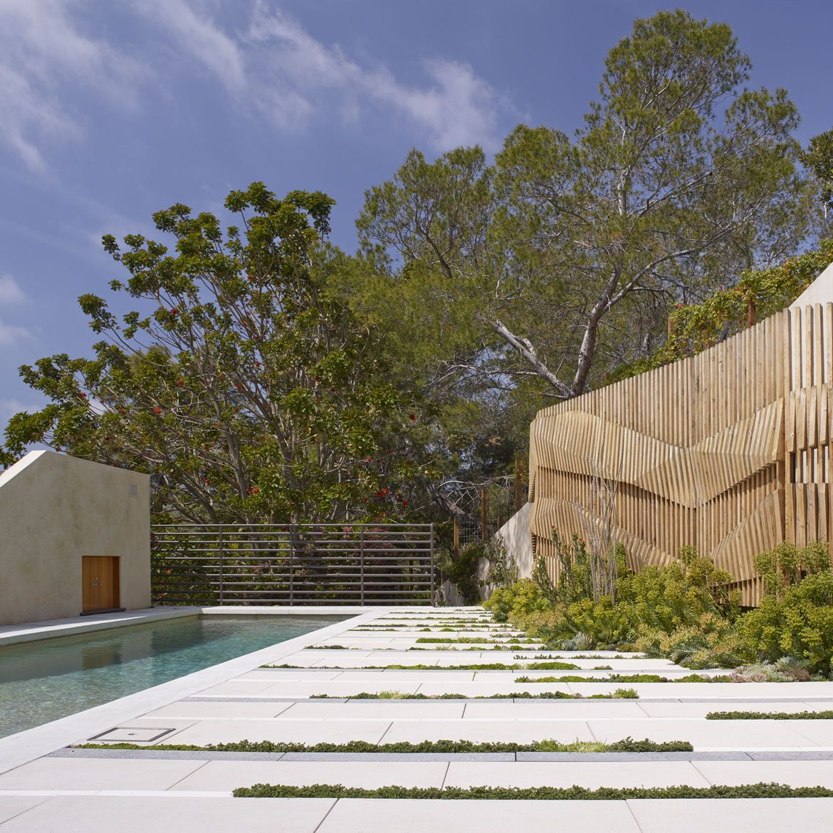 Undulating Wooden Wall And White Cast Stone Pavers From Napa Valley In Los Angeles Pool Patio