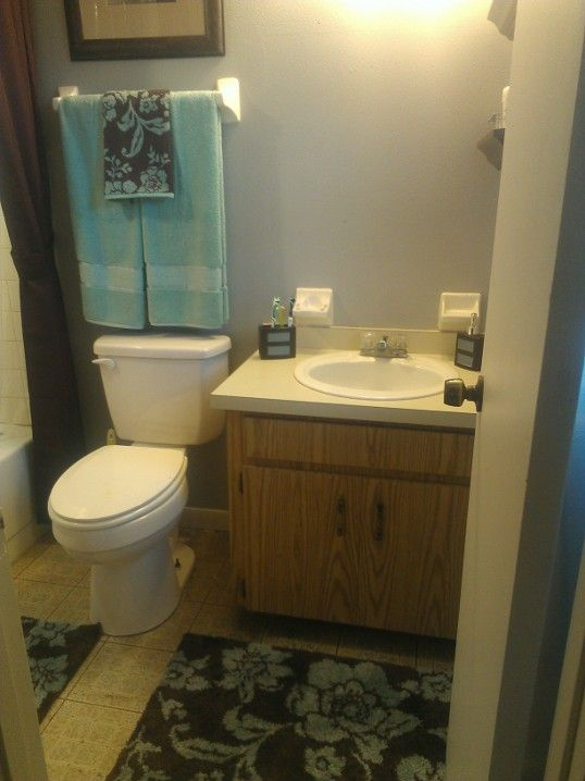 Teal And Brown Bathroom From On Soft Grey Wall