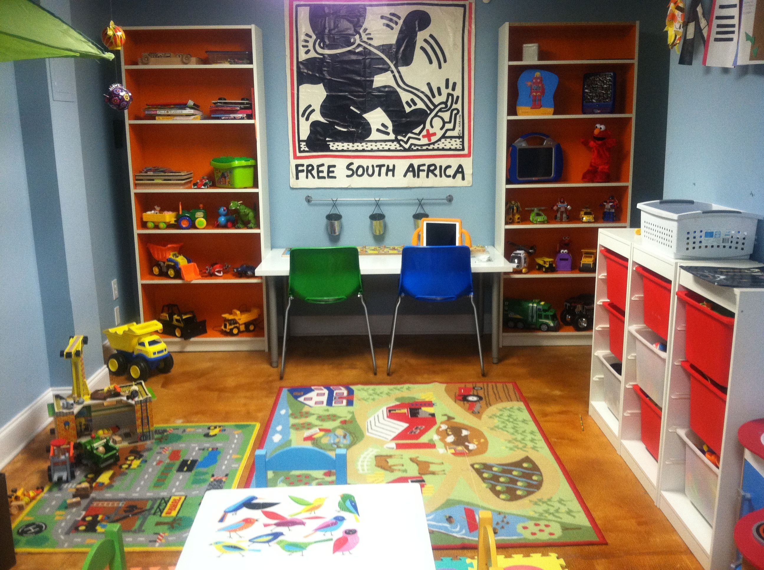 #playroom #kidland I fell in love with these new limited edition billy book cases at IKEA. I put a work surface with adjustable legs to grow with the kids in between the book cases. I am still committed to my Keith Haring poster that is, I guess you could call it Vintage original from the mid 80's- salvaged from my father's bachelor pad. I am pleased with its incorporation into the playroom.