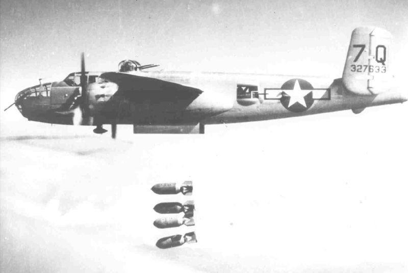 B-25J 7Q 43-27633 dropping four 1000 pound bombs.