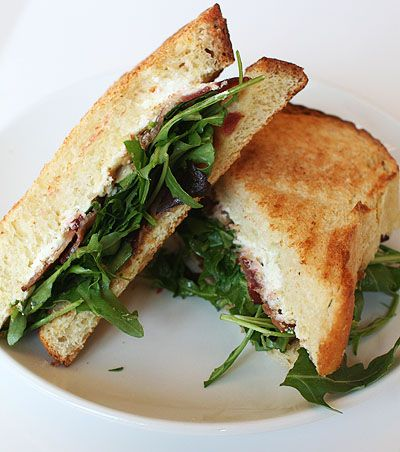 B A D  Bacon, Arugula, Almond Date Spread and Goat Cheese on