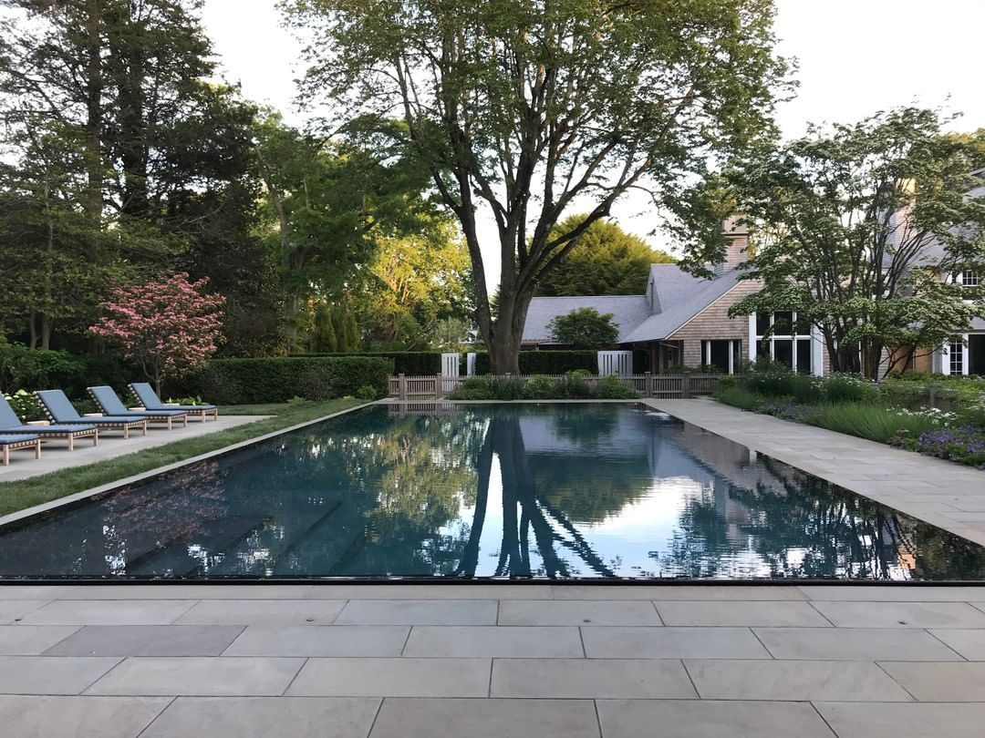 Hollander Design On Instagram This Rimless Edge Pool Reflects Sky And Tree Like Glass Hollanderdesign Pool In 2020 Pool Natural Stone Wall Pool Designs