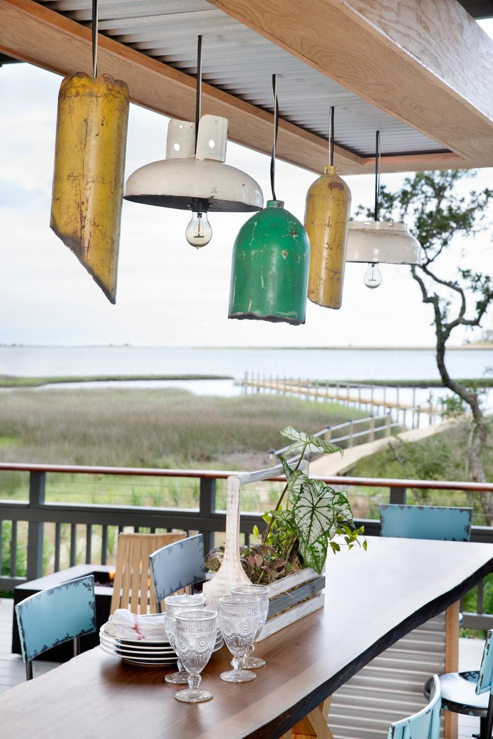 Located underneath the home on stilts, the lower deck offers an inviting space for entertaining and lounging.