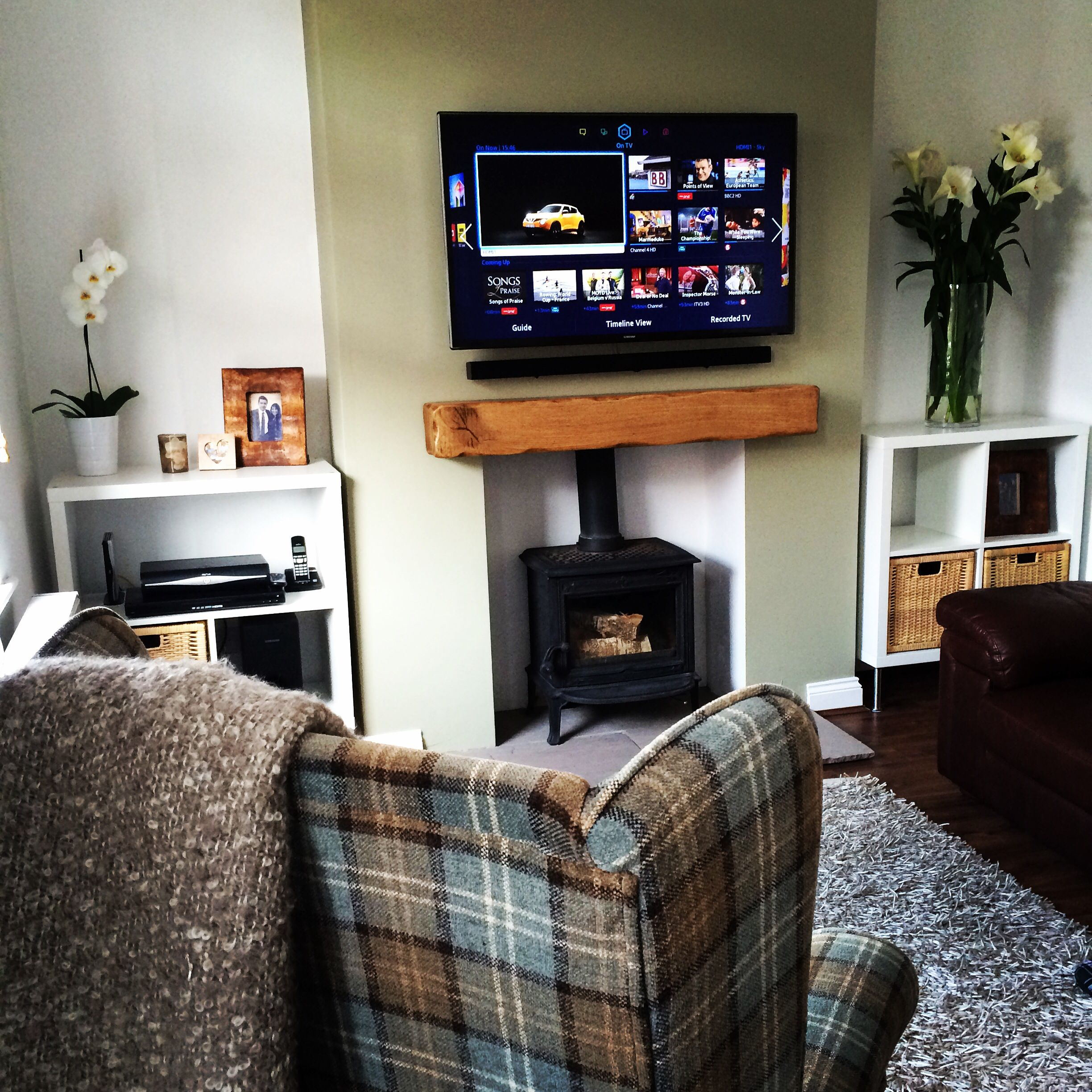 Living room log burner with floating oak beam mantle tartan wing