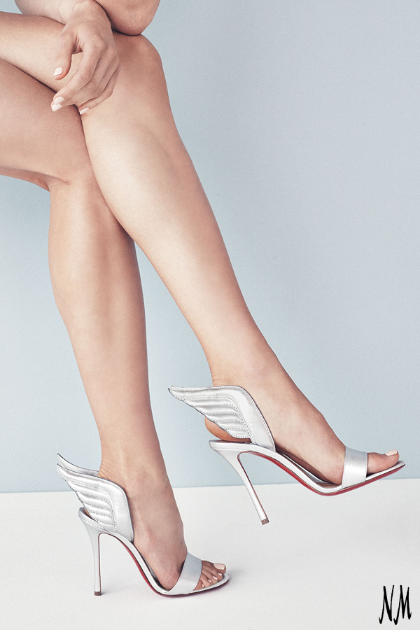 52bf7a895cd Take flight in metallic winged pumps by Christian Louboutin. Style with a  mini dress for a night out with the girls.