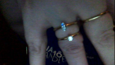 """""""The 2 diamond solitaire rings I found in Diamond Candles. The marquise is a 1/4 carat in 14K, the round is 1/5 carat in 14K...the ring on the mid finger is turned around and the band is 10K...note the color difference...cool huh? lol!"""" - Wendie Lather"""