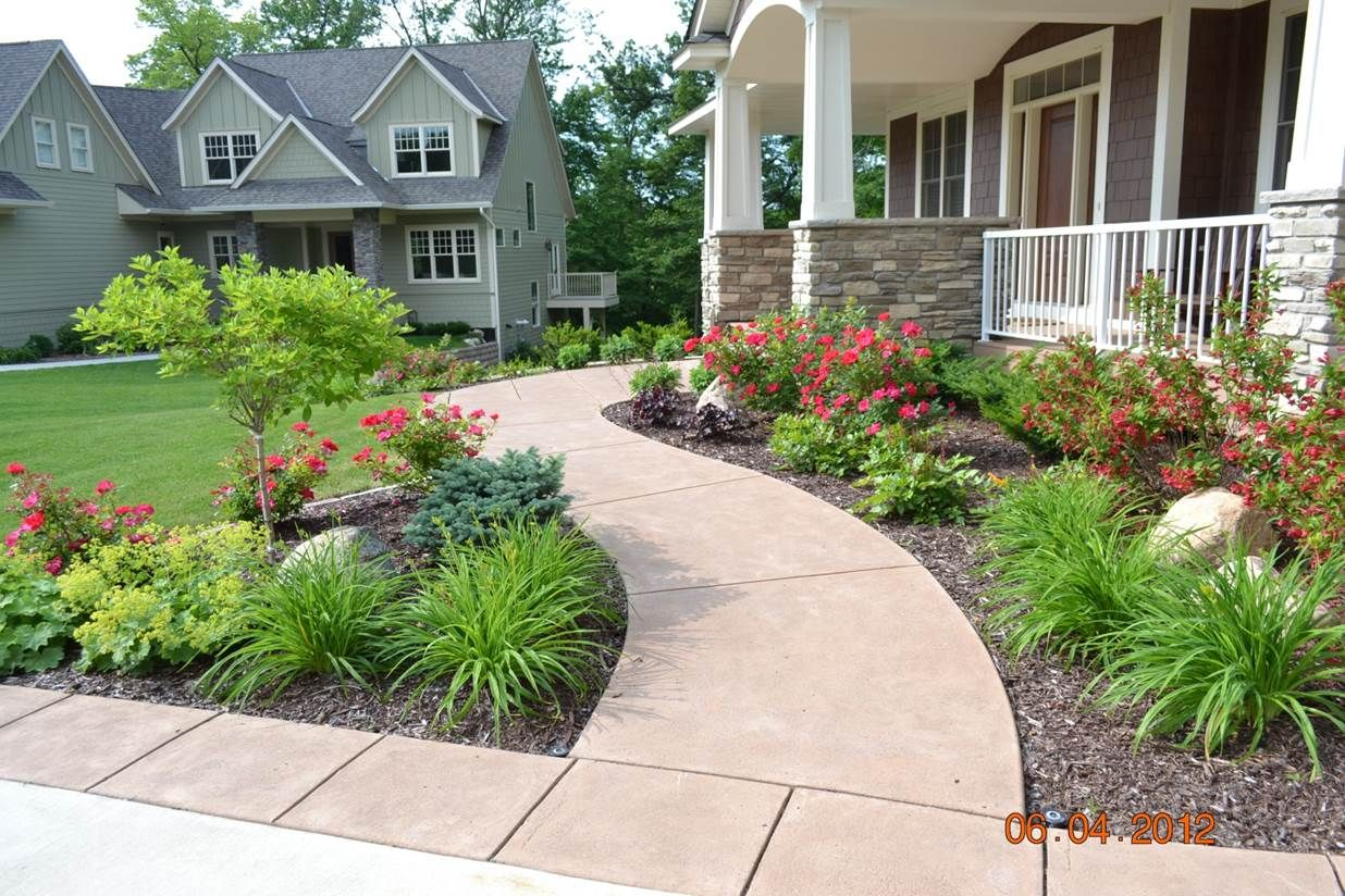 Beautiful example of curved sidewalk and large planting for Ideas for front yard plants